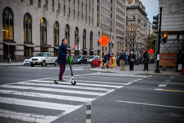 An electric scooter user in downtown D.C. ( Photo by ERIC BARADAT/AFP/Getty Images)