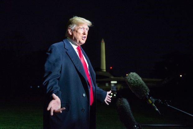 Trump speaks to reporters at the White House on Saturday. Photographer: Erin Scott/Polaris/Bloomberg