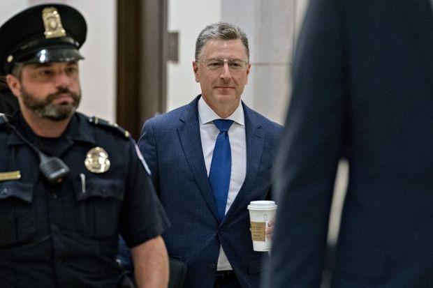 Volker arrives for a closed door deposition