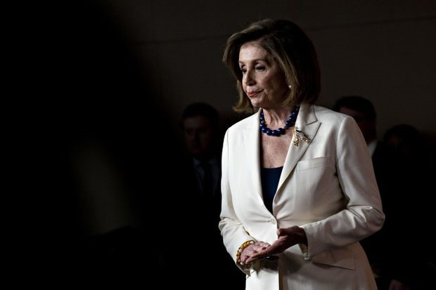 Pelosi announced the House's plans on impeachment at the Capitol on Thursday - Andrew Harrer/Bloomberg