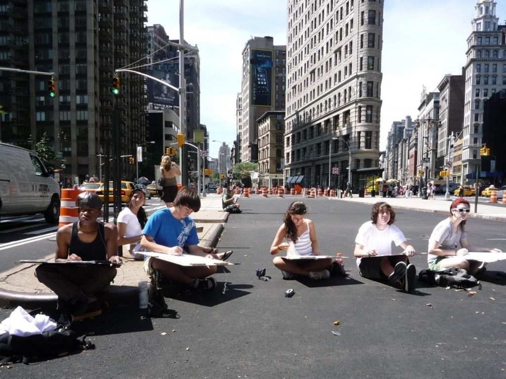 Art students sit on freshly-paved Broadway while construction continues around them to create the Flatiron/Madison Square Plaza in 2008.