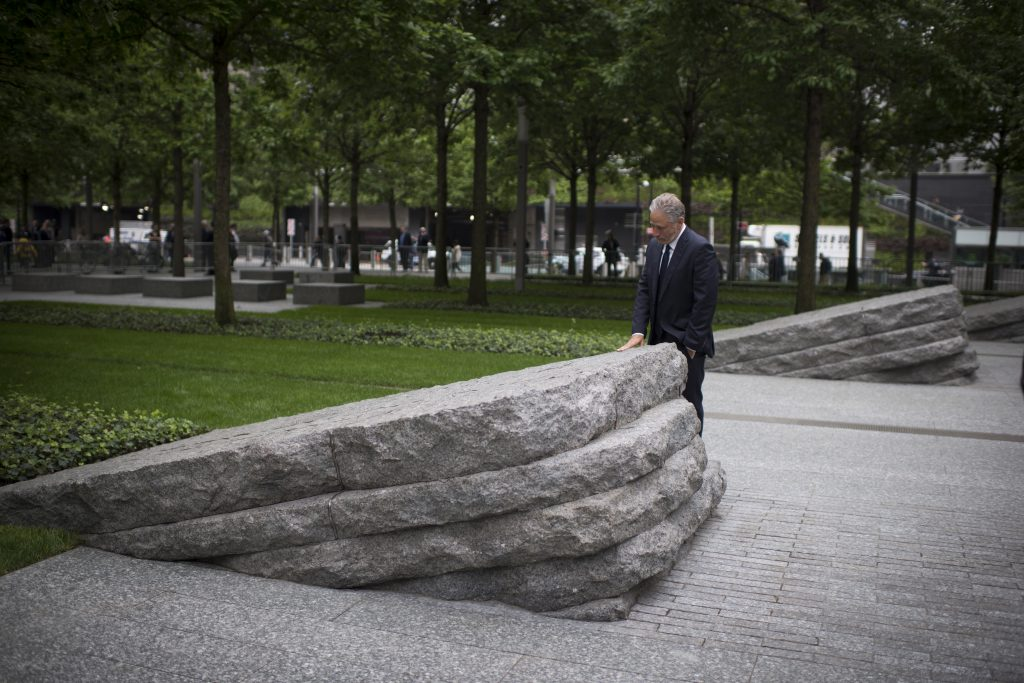 Jon Stewart next to a stone monolith at the 9/11 Memorial Glade dedication ceremony in May, 2019.