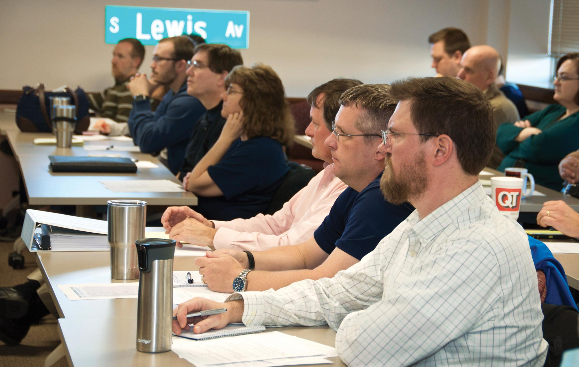 City government workers and community members listen to a presentation in Tulsa, Oklahoma, on the Urban Data Pioneers program, which recruits volunteers to analyze city data to help understand and solve local problems.