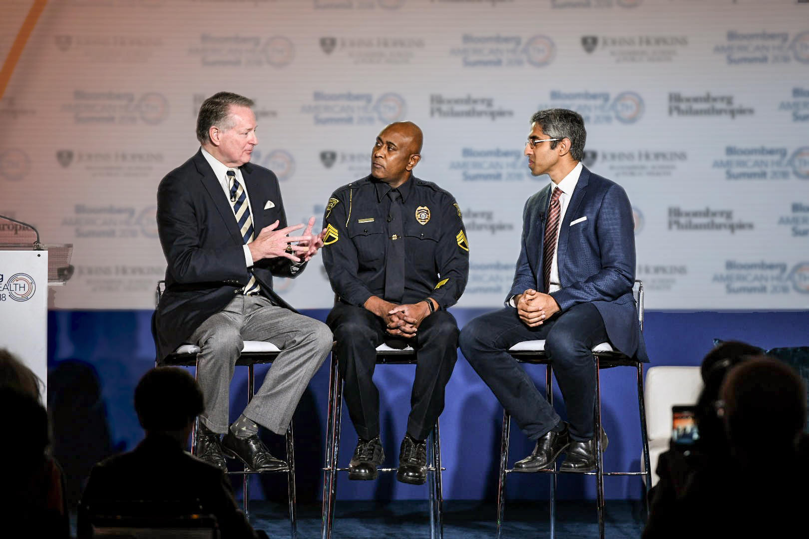 Mayor Steve Williams of Huntington, West Virginia, discusses his city's response to the opioid crisis with Huntington Police Sergeant Paul Hunter and the 19th United States Surgeon General Vivek Murthy at the Bloomberg American Health Summit in Washington, D.C.
