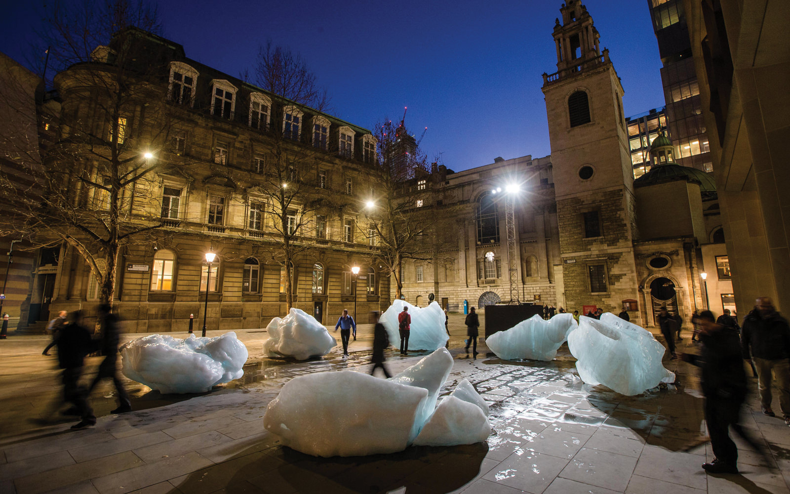 Visitors move through Ice Watch outside of Bloomberg L.P.'s European headquarters in London.