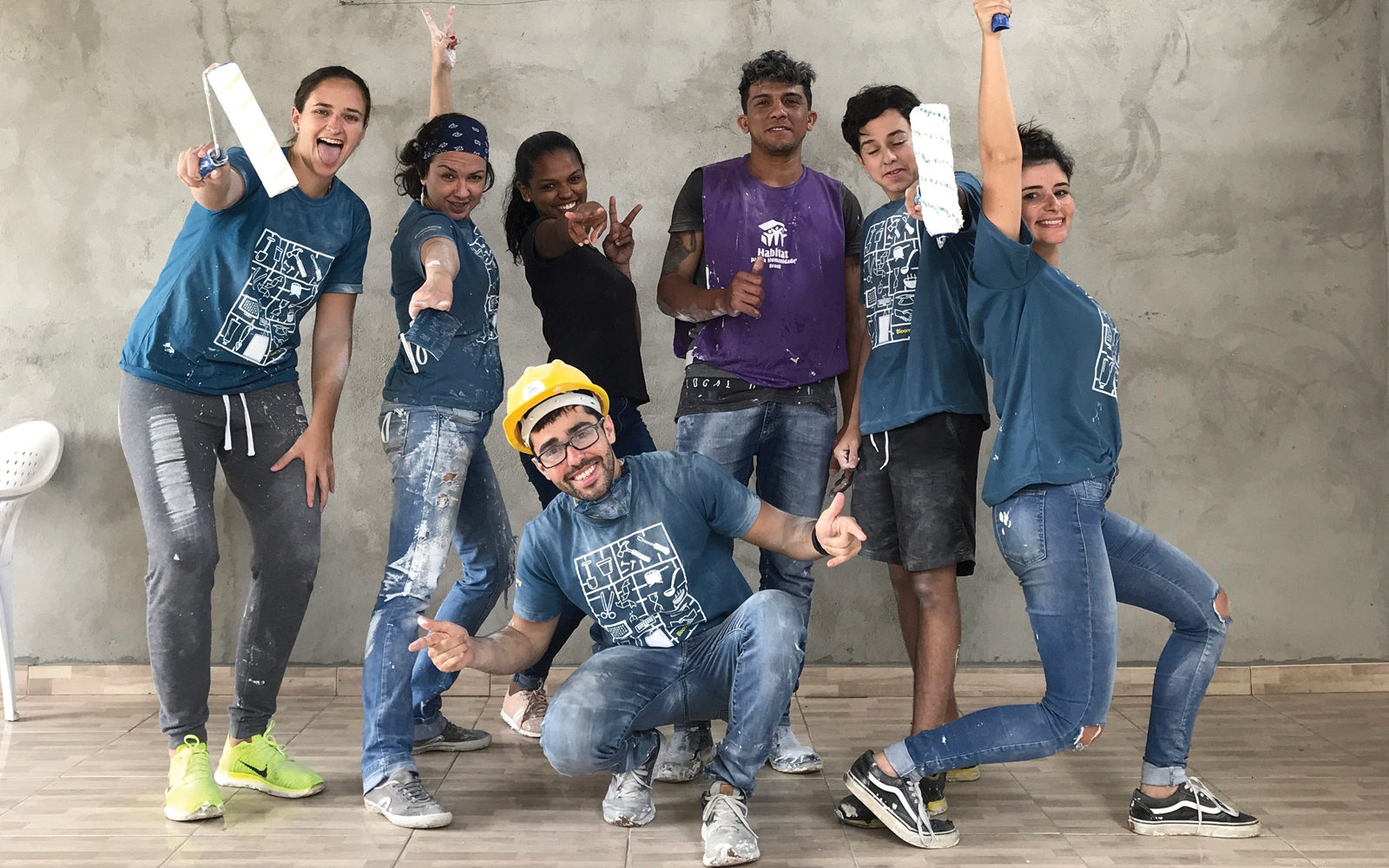 Bloomberg L.P. volunteers in São Paulo, Brazil, help paint a project with Habitat for Humanity organizers.