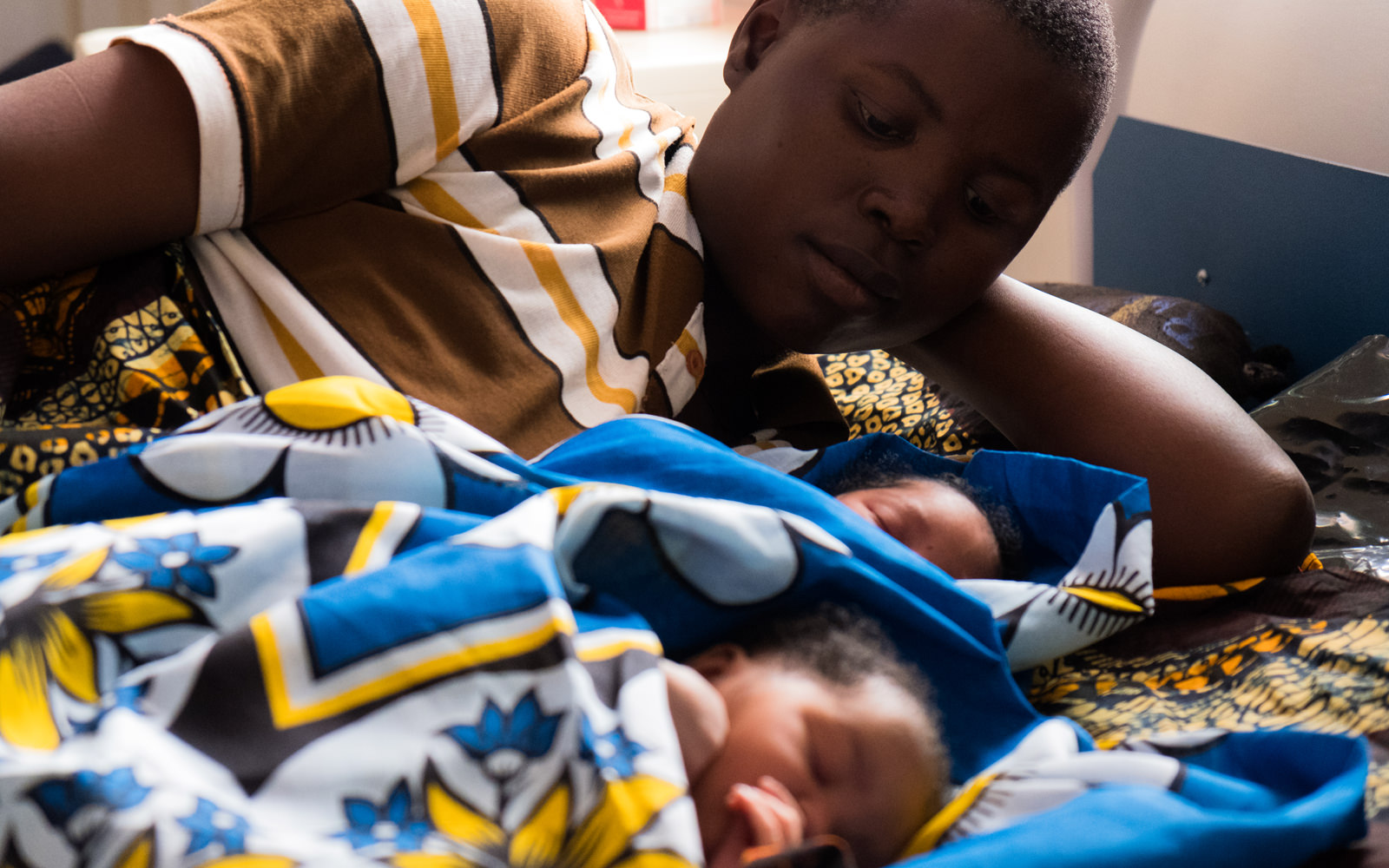 Mother with children in a health center's maternity ward in Kigoma, Tanzania, the region that has been the focus of Bloomberg Philanthropies' Maternal Health program.