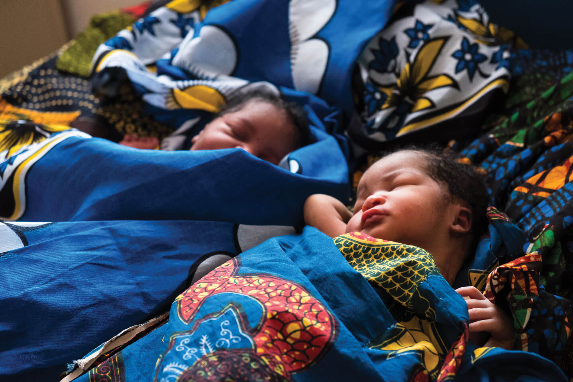 Babies nap in a Bloomberg Philanthropies-supported health center's maternity ward in Tanzania.