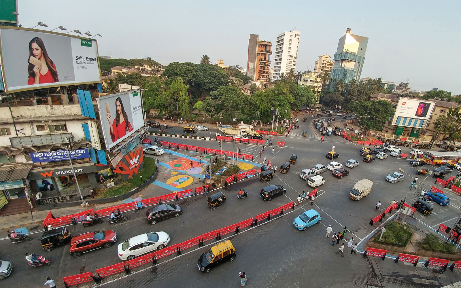 A busy intersection in Mumbai, India, was redesigned with colorful barriers and crosswalks, making pedestrians, cyclists, and drivers safer.