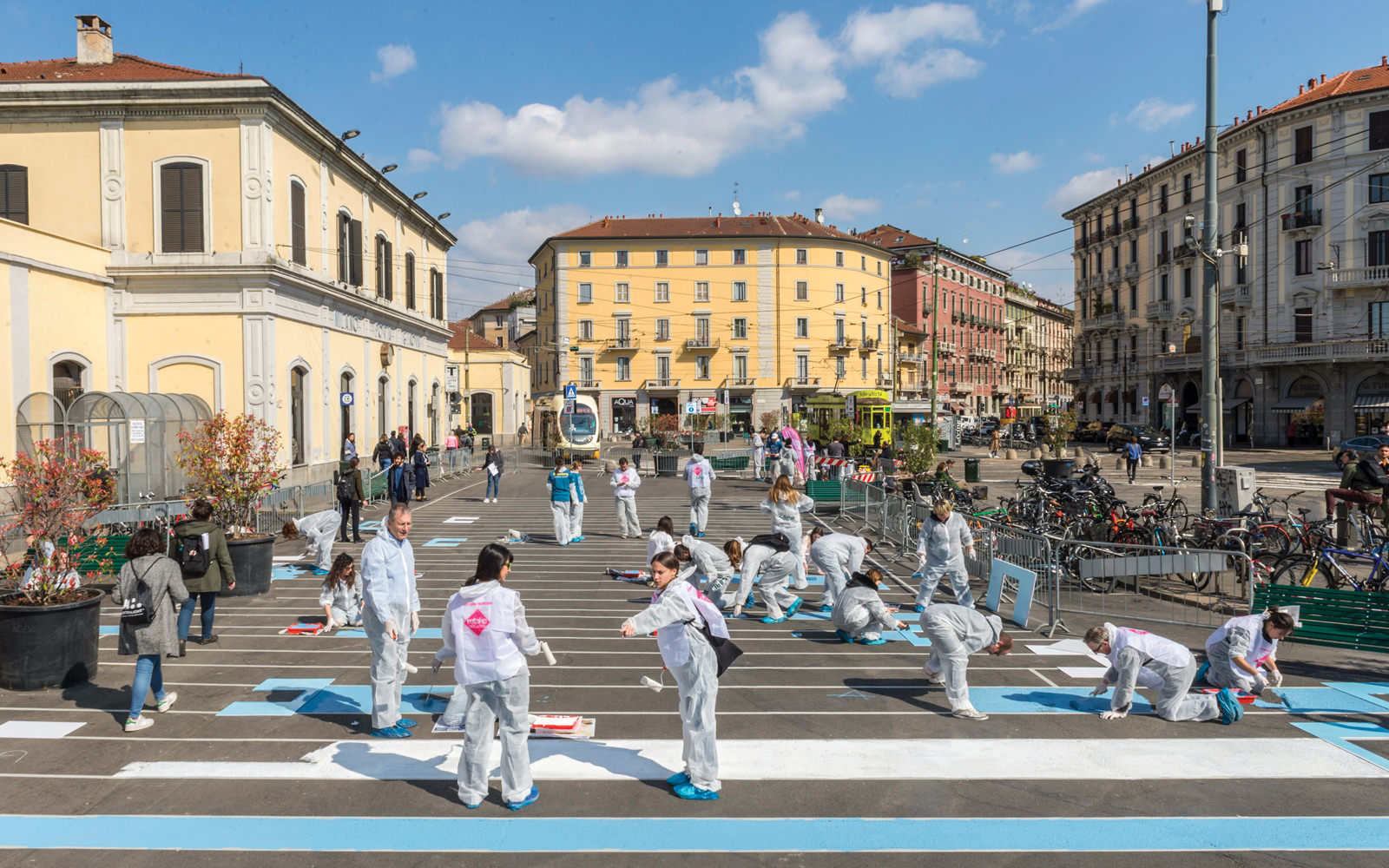 Bloomberg L.P. volunteers paint a pedestrian plaza in Milan, Italy, designed by the Bloomberg Associates team in partnership with the city.