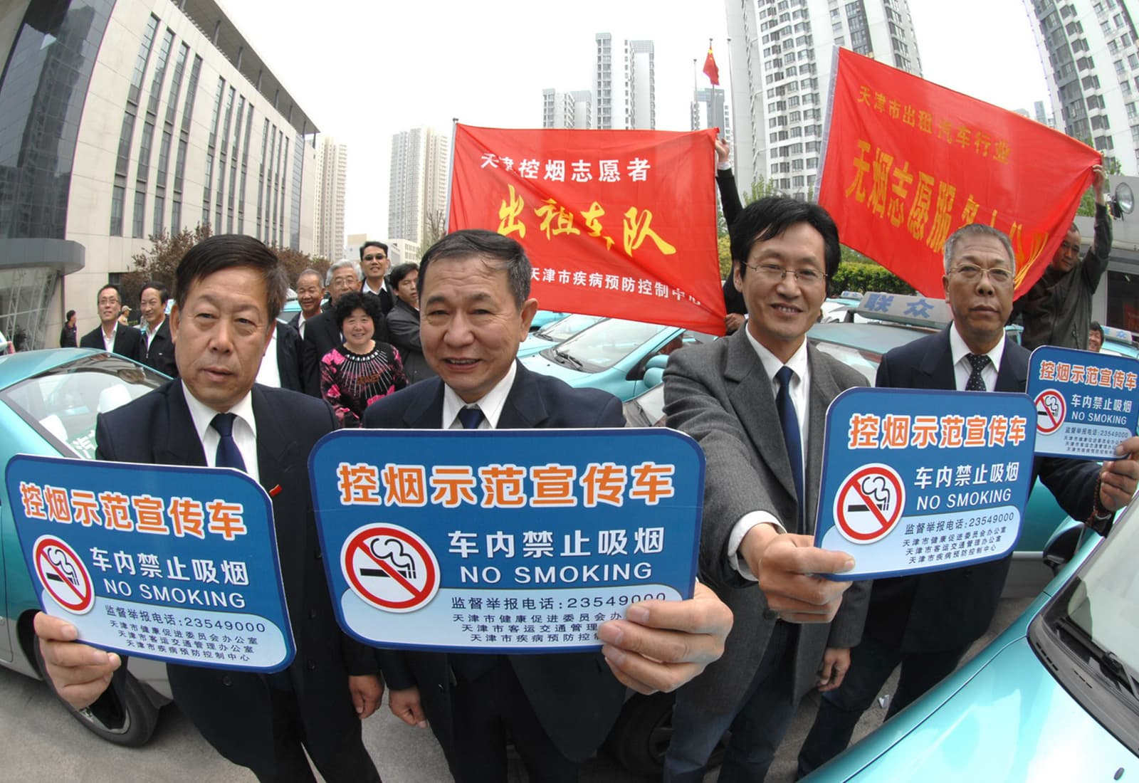In China, taxi drivers proudly display their no smoking signs.