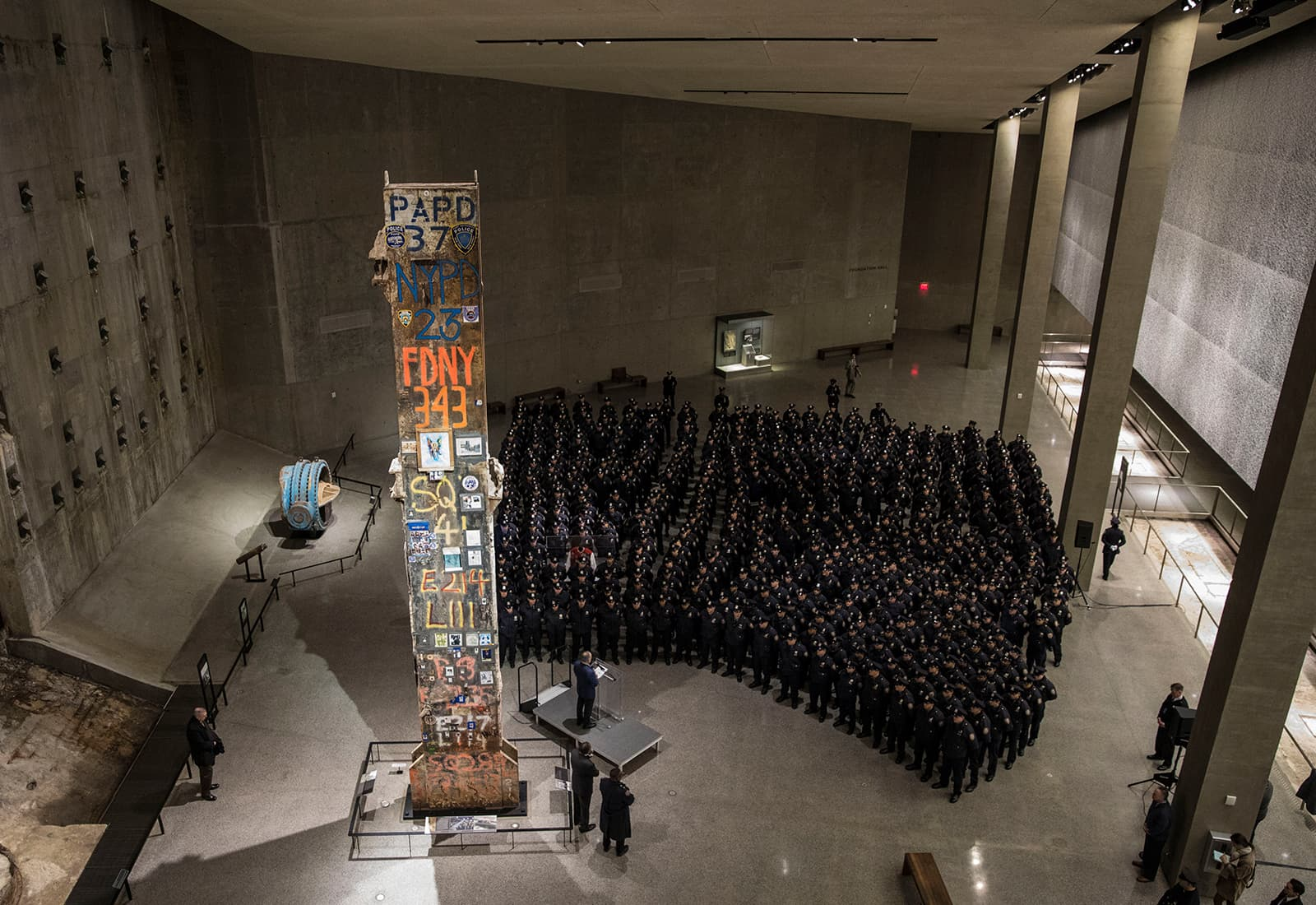 """The symbolic """"Last Column,"""" a steel beam from one of the World Trade Center towers, stands near the slurry wall that held back the Hudson River from the site."""