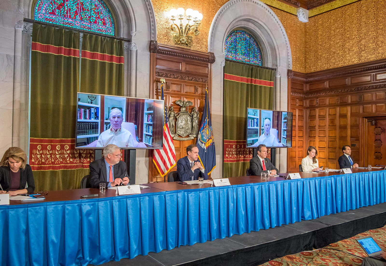 New York Governor Andrew Cuomo announces the state's contact tracing pilot program with support from Mike Bloomberg and Bloomberg Philanthropies. Cuomo sits with members of his administration during a press conference with Mike Bloomberg joining in via video conference call.