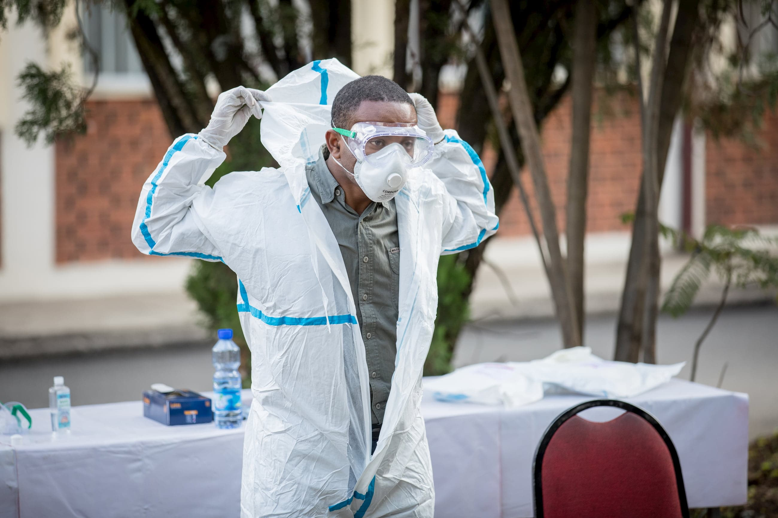 For the PPE training, trainees in Addis Ababa, Ethiopia are putting on PPE equipment.