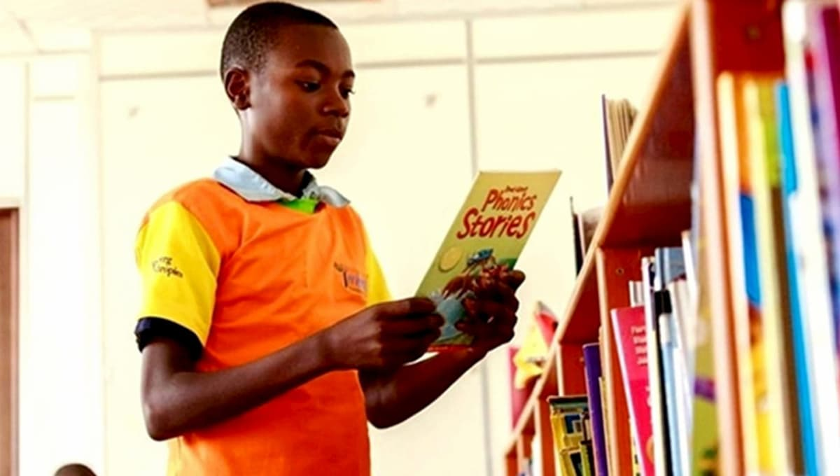 A student reading books at the launch of the Library for All mobile app in Kigali, Rwanda.