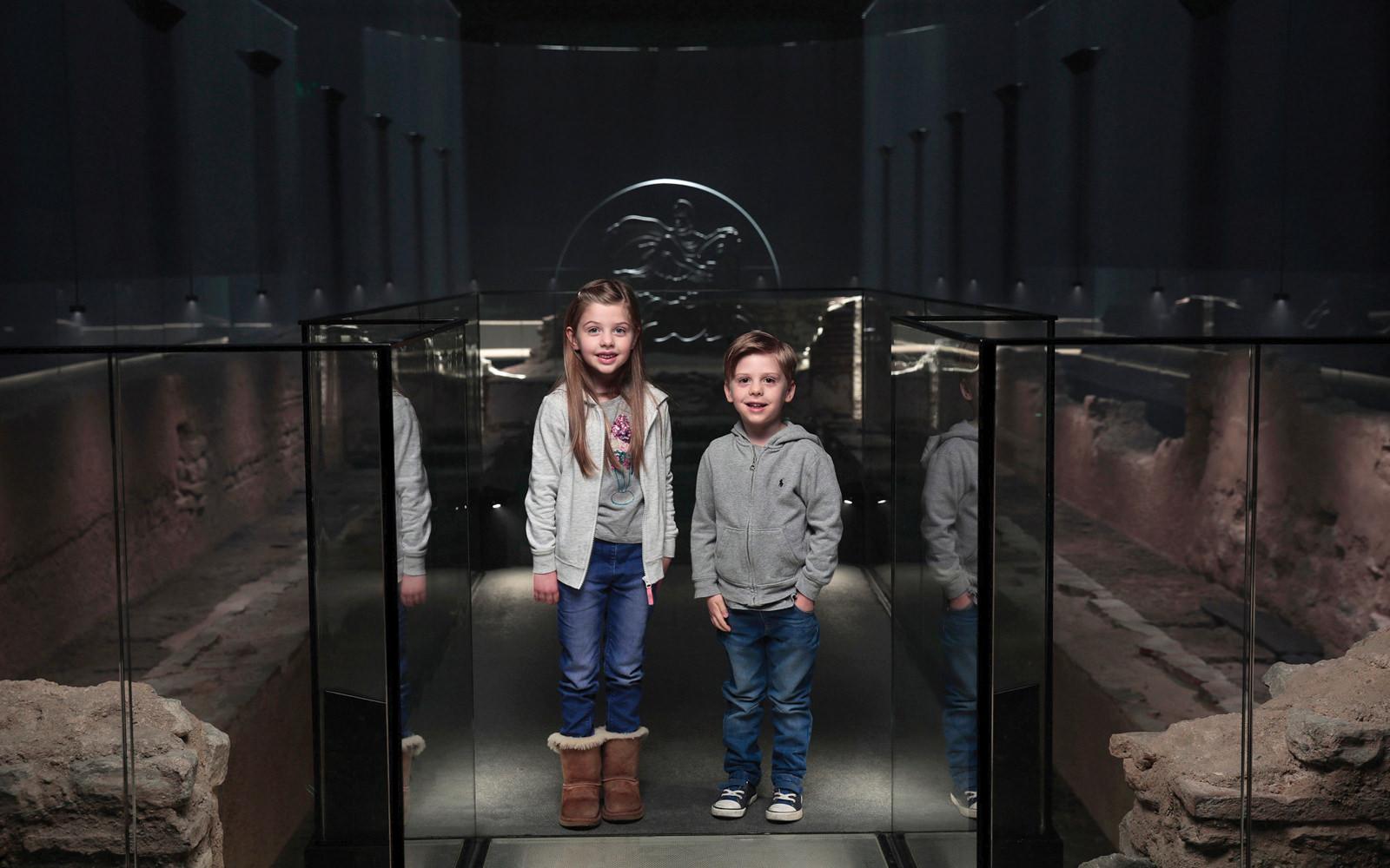 Children exploring the London Mithraeum at Bloomberg L.P.'s European headquarters.