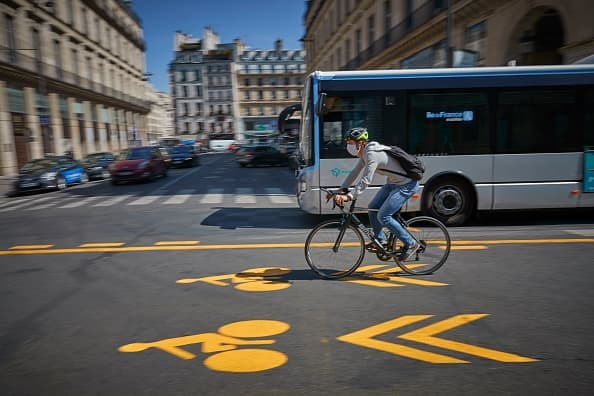 Cities around the world have seen a dramatic increase in cycling during the pandemic. Former client city Paris is one such city growing its cycling infrastructure. Credit: Kiran Ridley/Getty Images