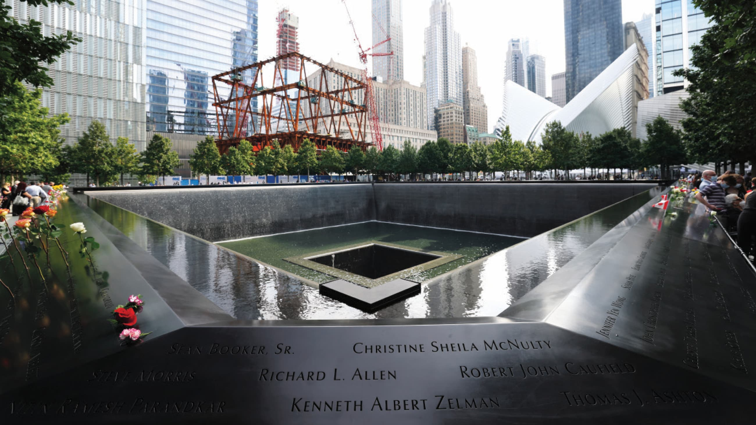 The 9/11 Memorial with the Ronald O. Perelman Performing Arts Centerrising in the background.