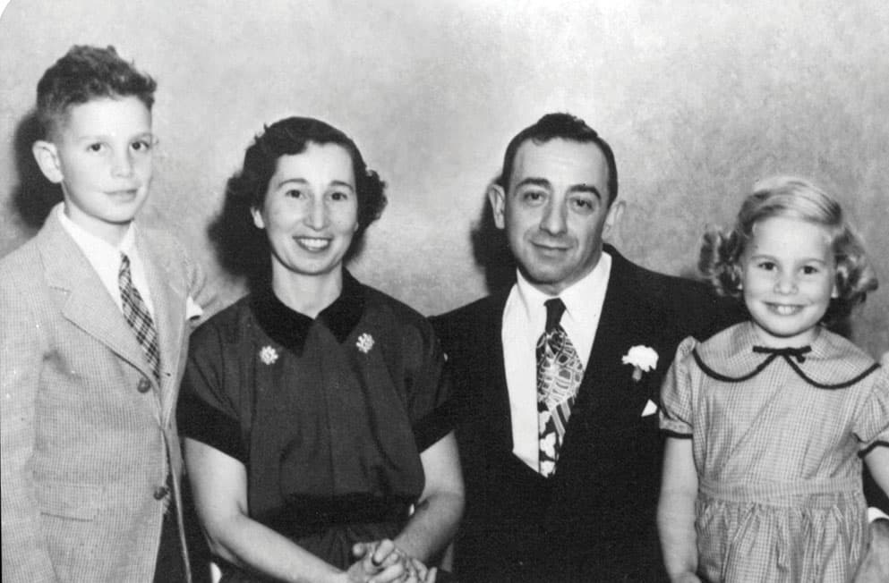 A family photograph of Mike with his sister and parents