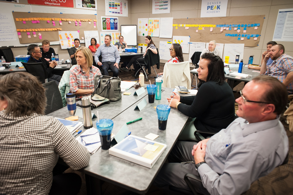 Photo of city employees participating in a Denver Peak Academy learning session