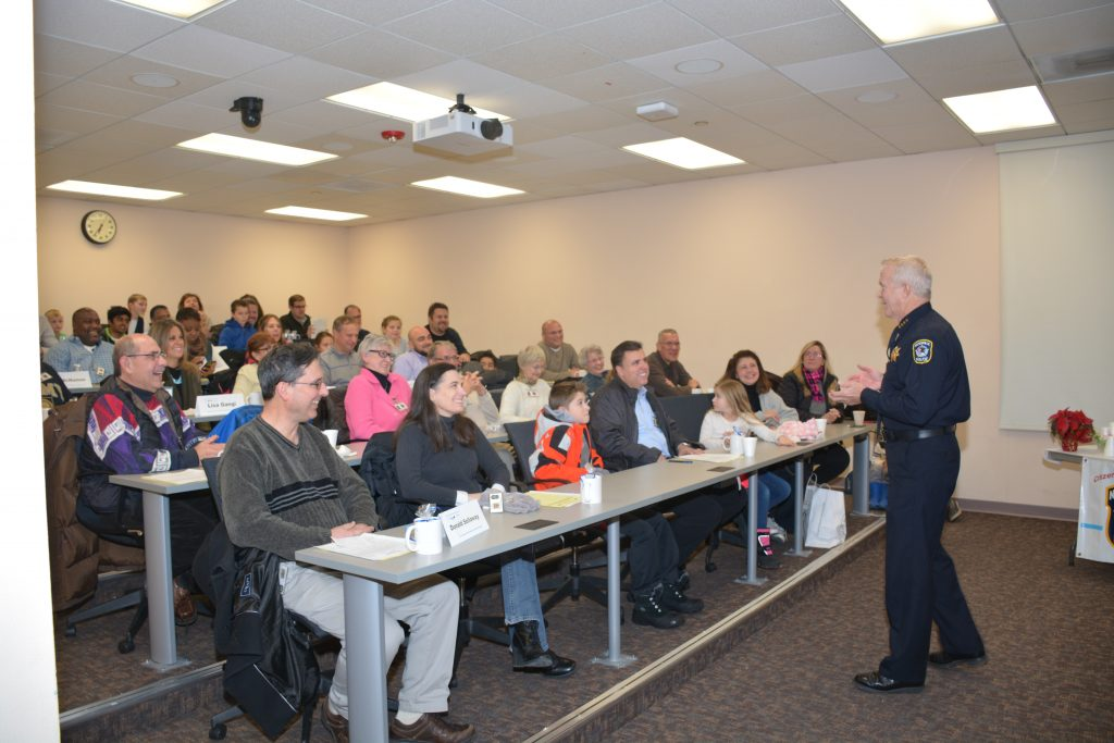 Naperville Police Chief Robert Marshall addresses Naperville's 2016 Citizen Police Academy participants and their families at their graduation