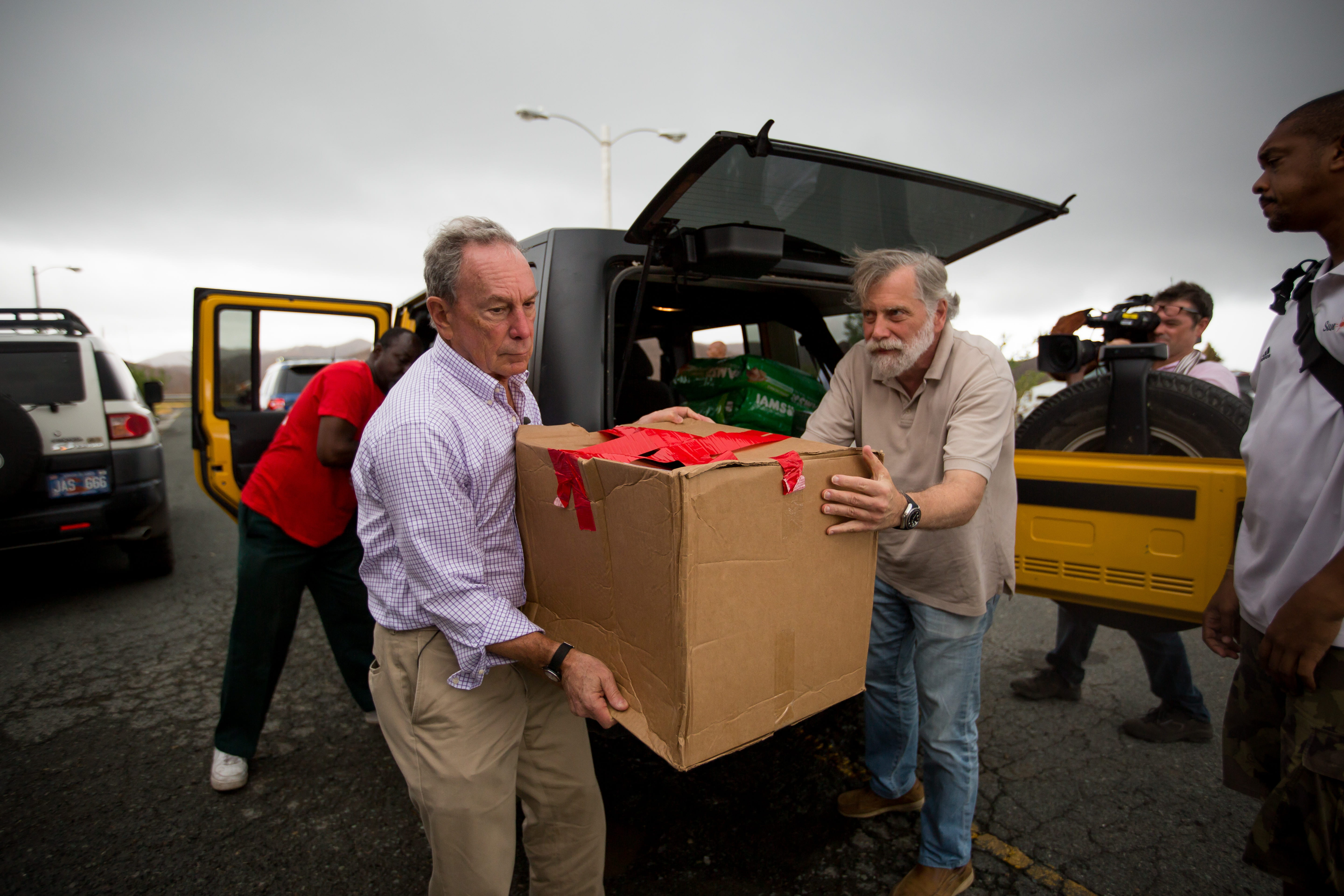Mike Bloomberg carries boxes of supplies in the U.S. Virgin Islands following the hurricanes of 2017.
