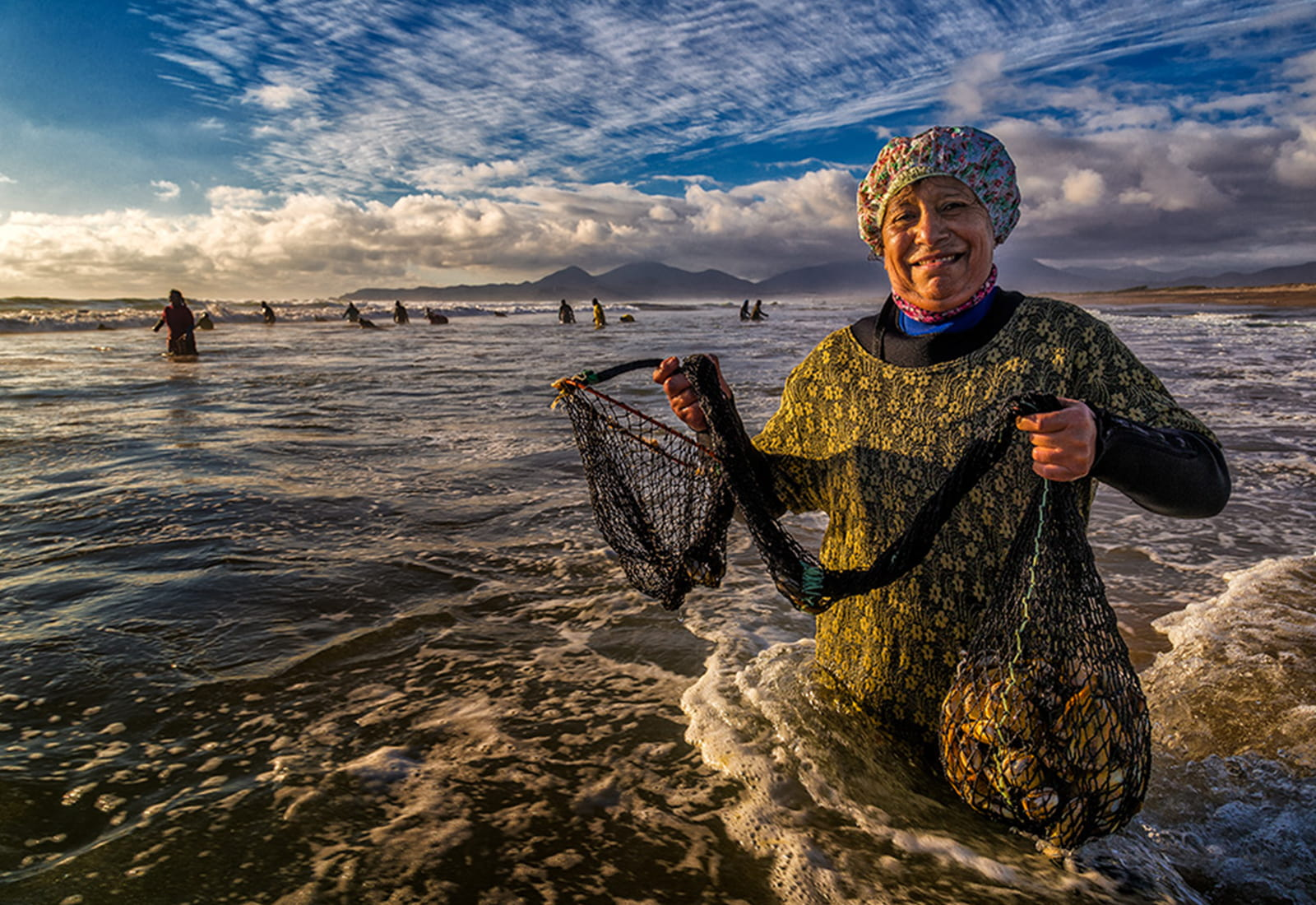 A local woman sustainably fishes in Brazil, ensuring our ocean survives and thrives in the face of climate change.