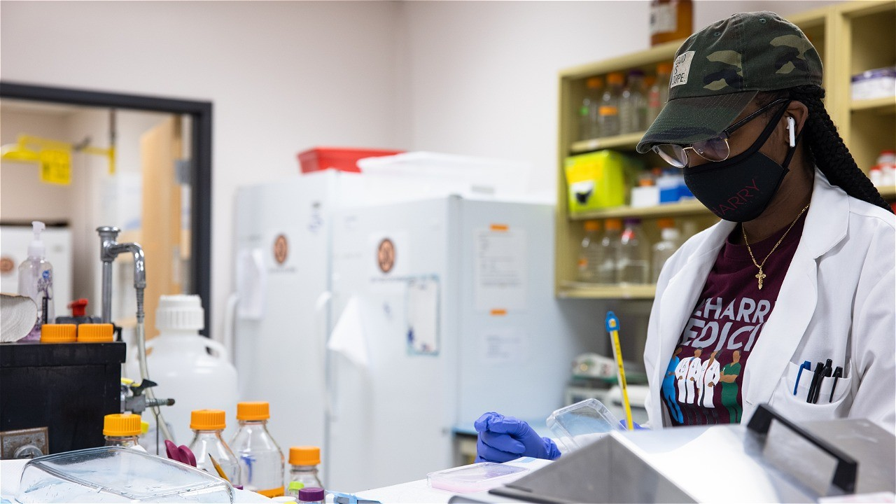 A Black medical school student from Meharry Medical College in a lab.