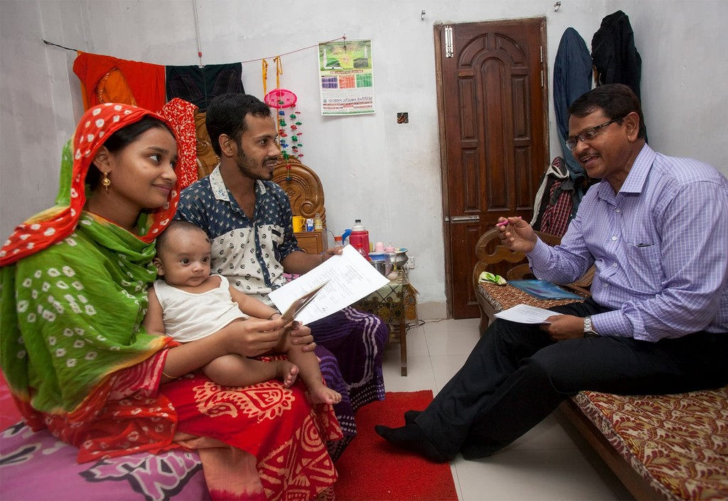 Bangladesh family participates in Data for Health program, recording birth and death information with local officials to find out how best to allocate resources and find solutions to improve and save lives.
