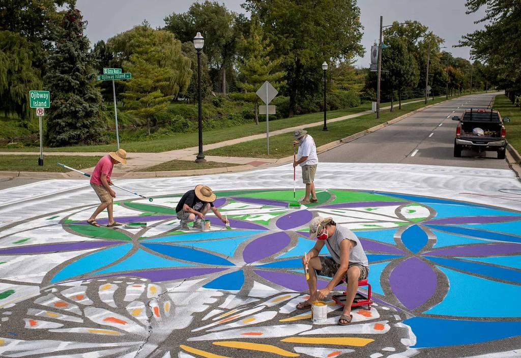 Local artists in Saginaw, Michican work to create street murals as part of Bloomberg Philanthropies' Asphalt Art Initiative.