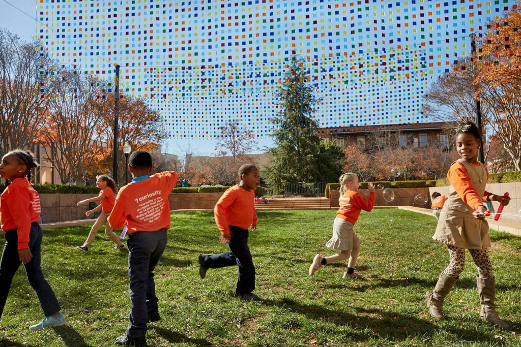 """Community members at the opening of artist Erwin Redl's work, """"Seeing Spartanburg in a New Light,"""" one of four winning projects for the inaugural Bloomberg Philanthropies Public Art Challenge."""