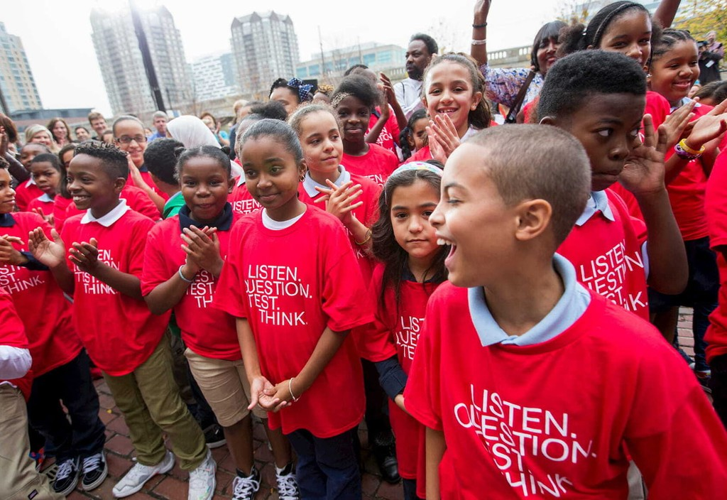 Local students attend the opening of the education division at Boston's Science Museum, the William and Charlotte Bloomberg Science Education Center, named after Mike Bloomberg's late parents.