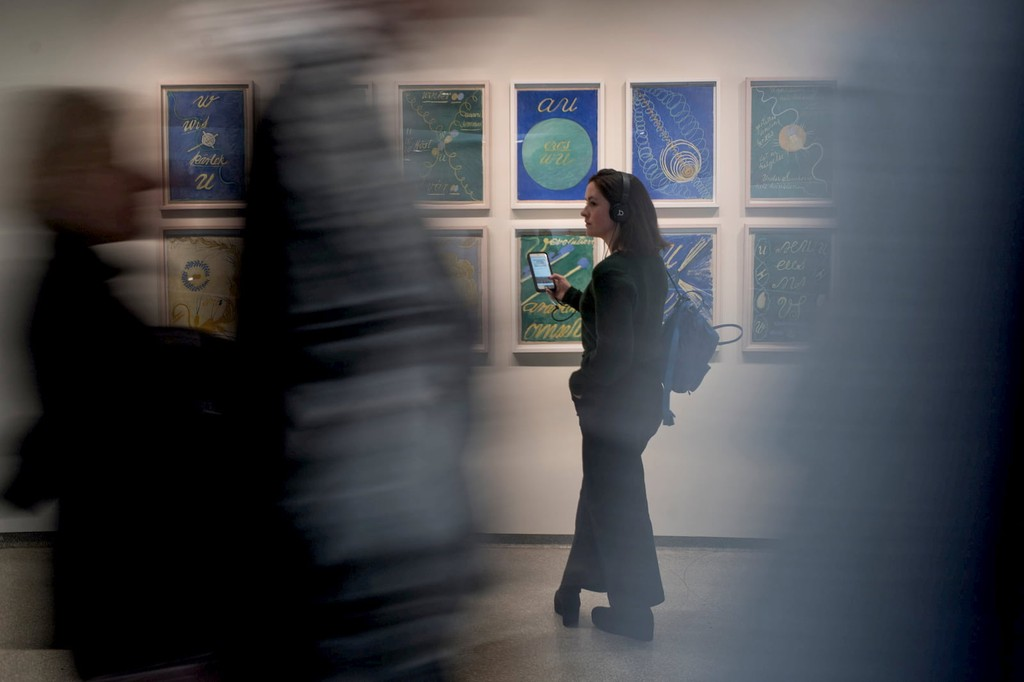 A visitor exploring an exhibition at The Solomon R. Guggenheim Museum using the free Bloomberg Connects mobile app.