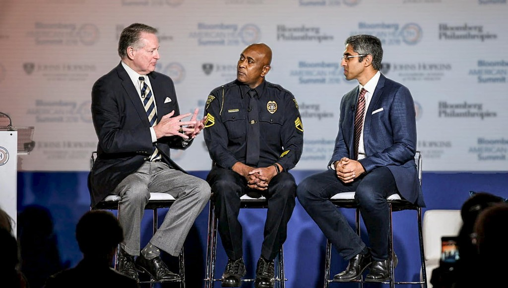 Mayor Steve Williams of Huntington, West Virginia, discusses his city's response to the opioid crisis with Huntington Police Sergeant, Paul Hunter, at the Bloomberg American Health Summit in Washington, D.C.
